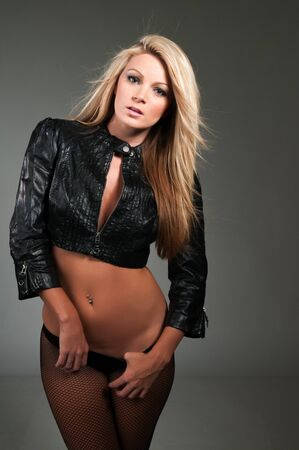 black leather: Beautiful curvy blonde in a black leather jacket