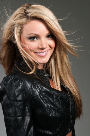 Beautiful curvy blonde in a black leather jacket