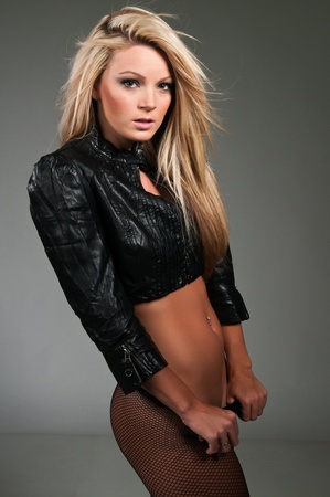 Beautiful curvy blonde in a black leather jacket Stock Photo - 10001436