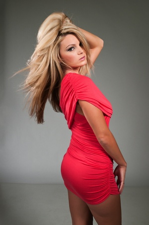 Beautiful curvy blonde dressed in a tight red dress