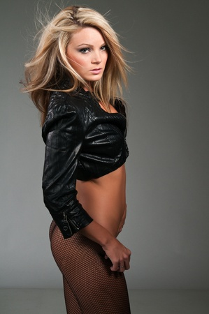Beautiful curvy blonde in a black leather jacket Stock Photo - 10001439