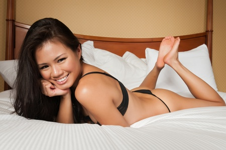 thong woman: Pretty young Singaporean woman in skimpy lingerie