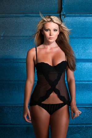 voluptuous: Beautiful curvy blonde dressed in black lingerie