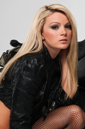 fishnet: Beautiful curvy blonde in a black leather jacket