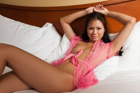 Pretty Singaporean woman in a transparent pink wrap Stock Photo - 10084752