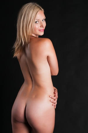 Beautiful tall blonde standing nude in shadow Stock Photo - 10084809