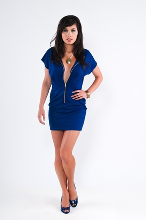 long legs: Beautiful young brunette in a blue dress