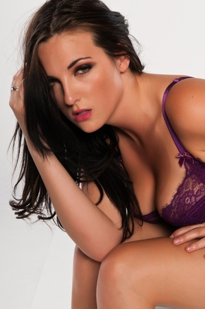 undergarments: Pretty young brunette dressed in purple lingerie