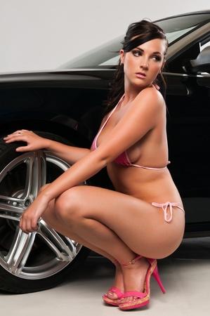 voluptuous women: Pretty young brunette in a pink bikini