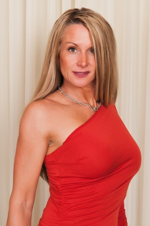 strong: Beautiful mature blonde in a red dress