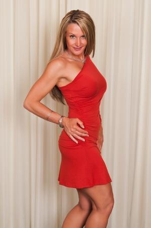 Beautiful mature blonde in a red dress