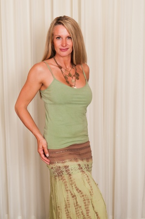 Beautiful mature blonde in hippie attire photo