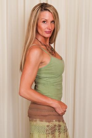 top: Beautiful mature blonde in hippie attire