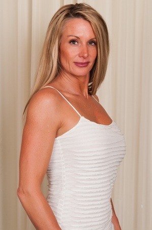 blouse sexy: Beautiful mature blonde in a white blouse Stock Photo