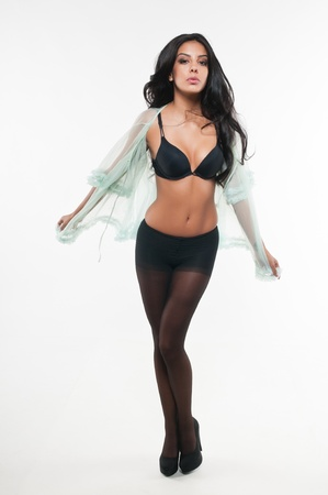 Beautiful young multiracial woman in black lingerie photo