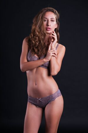Pretty young Israeli woman in mauve lingerie photo