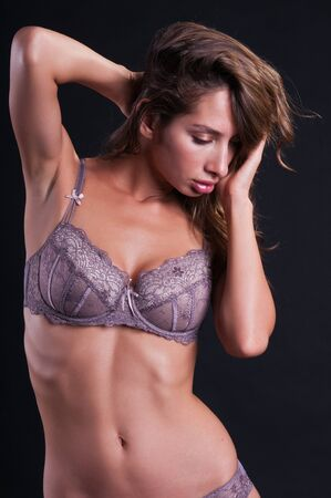Pretty young Israeli woman in mauve lingerie Stock Photo - 10420771
