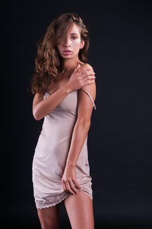 israeli: Pretty young Israeli woman in a pale mauve slip