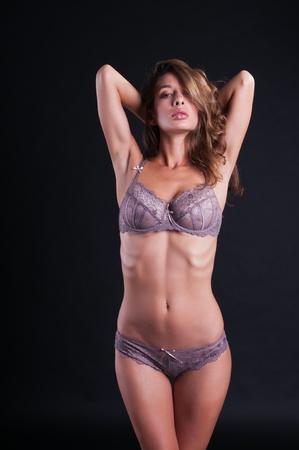 israeli: Pretty young Israeli woman in mauve lingerie
