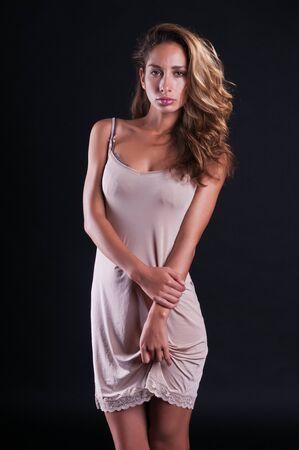 gorgeous woman: Pretty young Israeli woman in a pale mauve slip