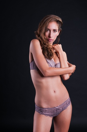 israeli: Pretty young Israeli woman in mauve lingerie