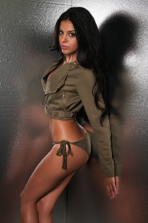Beautiful young multiracial woman in olive drab photo