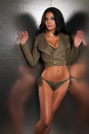 drab: Beautiful young multiracial woman in olive drab