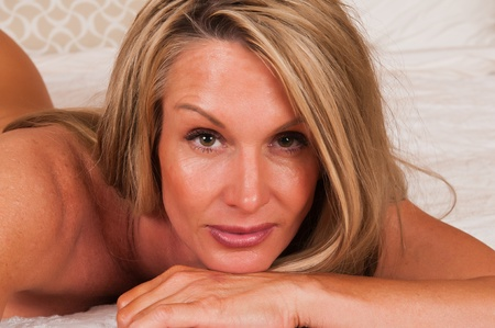 Closeup on the face of a beautiful mature blonde photo