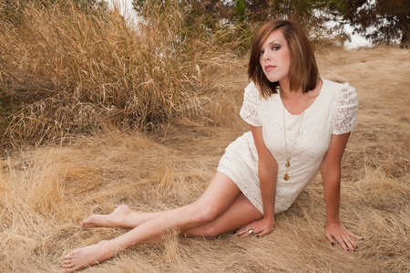 Tall pretty brunette in a white dress Stock Photo - 10478429