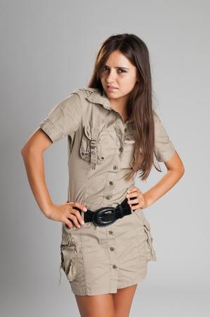 Pretty slender Romanian brunette in a safari dress photo