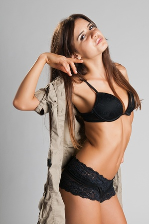Pretty slender Romanian brunette in black lingerie Stock Photo - 10573858