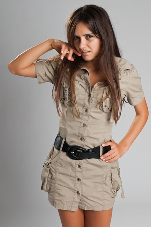 Pretty slender Romanian brunette in a safari dress Zdjęcie Seryjne