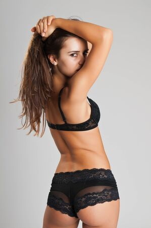 petite girl: Pretty slender Romanian brunette in black lingerie Stock Photo