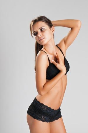 Pretty slender Romanian brunette in black lingerie photo