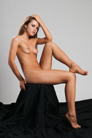 Pretty slender Romanian brunette posing nude Stock Photo - 10614382