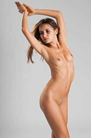 Pretty slender Romanian brunette posing nude Stock Photo - 10614308