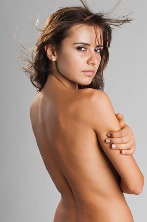 nude woman back: Pretty slender Romanian brunette posing nude