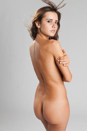 Pretty slender Romanian brunette posing nude