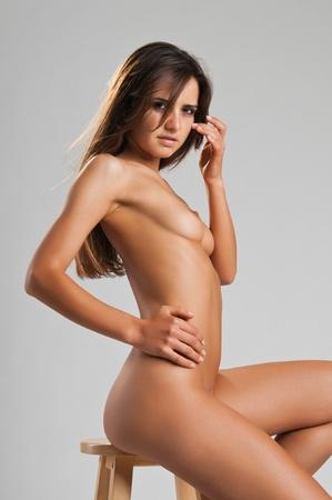 Pretty slender Romanian brunette posing nude Stock Photo - 10614421