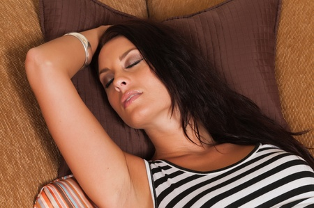 woman on couch: Beautiful tall brunette in black and white stripes Stock Photo