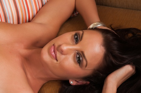 Closeup on the face of a beautiful reclining brunette Stock Photo - 10614426