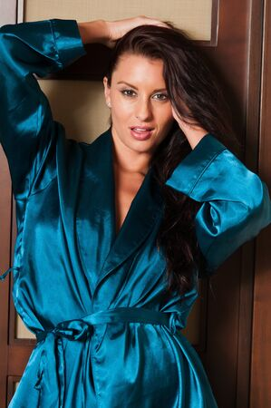 Beautiful tall brunette dressed in a blue robe Stock Photo - 10637915