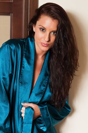 Beautiful tall brunette dressed in a blue robe