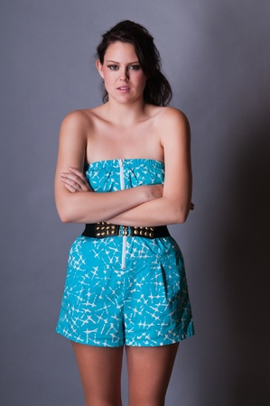 strapless: Tall young brunette in a skorts jumpsuit Stock Photo
