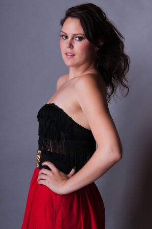 Tall young brunette in red and black photo