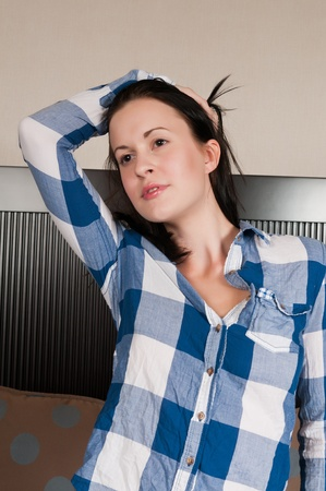 checked shirt: Pretty slender brunette in a checked shirt Stock Photo