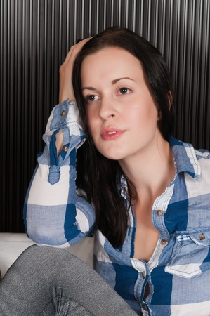Pretty slender brunette in a checked shirt and jeggings Stock Photo - 10908368