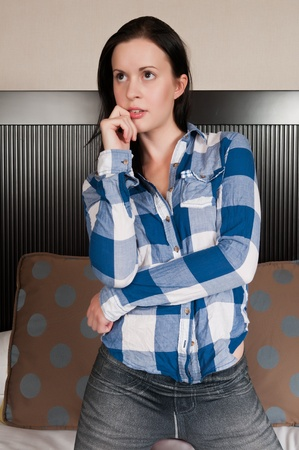 checked shirt: Pretty slender brunette in a checked shirt and jeggings
