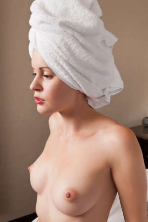 Pretty slender brunette drying off after a bath Stock Photo - 10945785