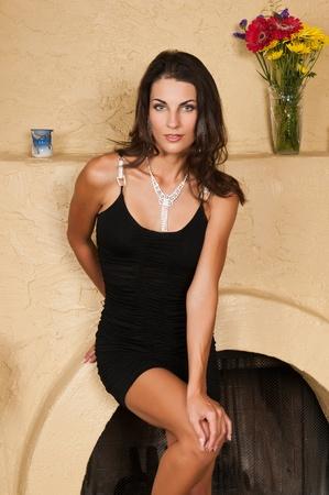 Beautiful Czech woman in a little black dress 免版税图像